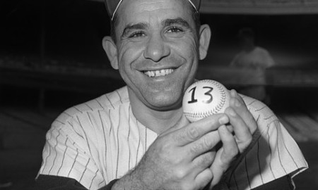 01 Oct 1962, Probably New York, New York, USA --- Lucky 13. So Yogi Berra holds a ball numbered 13.  So it will be his 13th World Series. So what else in new, says Yogi's sunburst? --- Image by © Bettmann/CORBIS