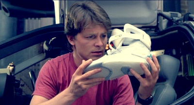 MJF marvels over his first pair of NIKE Mags. Photo Courtesy of Universal Pictures