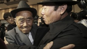 Oh Se In and his son, Oh Jang-kyun embrace for the first time in their lives. Photo Courtesy of AP.