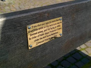 "Killjoy council officials have removed a series of comedy plaques put on a street benches - aimed at bringing a smile to shopper's faces. Pranksters made up the plaques to screw onto the shopping benches in the Banksy-style to liven up a city centre. But council officials removed the five plaques - after saying some people could be ""offended"" by them. © WALES NEWS SERVICE"