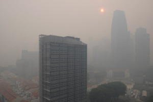 Buildings Vanish Behind the Daily Smog in Kuala Lumpur. Photo Courtesy of AFP